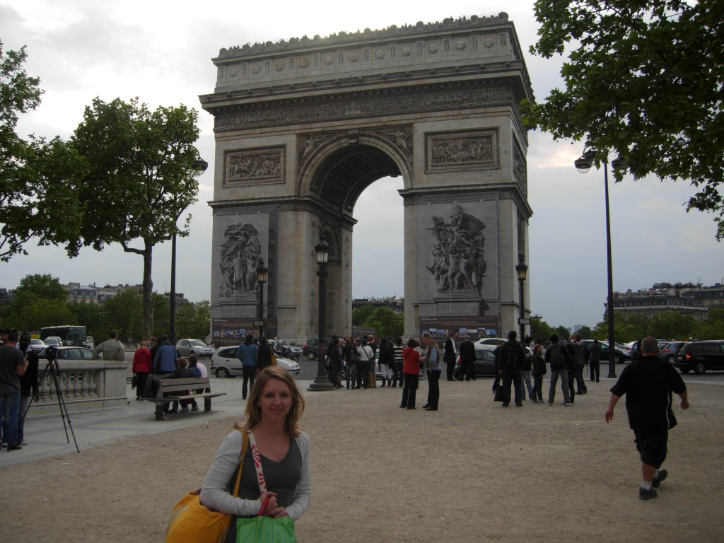 In front of the Arc de Triomphe in Paris.  See my bags? That's all I brought for our 10 day trip.