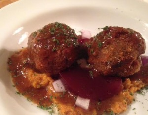 Stuffing Croquettes served with Sweet Potatoes, Cranberry, Gravy and Onions